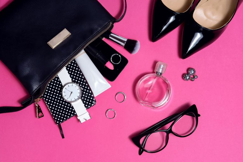 Top view female fashion accessories on pink flat lay