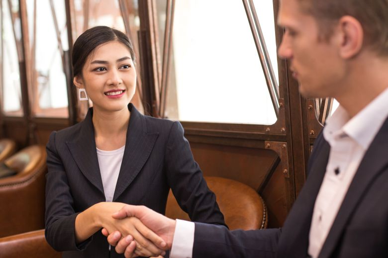 Asian Woman shaking hands for Business at restaurant, Woman working concept.