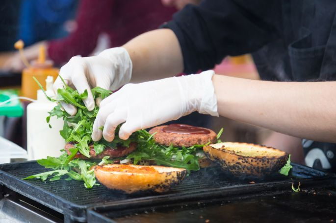 Beef burgers ready to serve on food stall.
